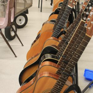 Guitars lined up in a row in the classroom